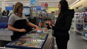 Shoppers Drug Mart customer, Ally Perryman buys a carbon monoxide alarm from part-time employee, Ashley Tayes Sunday evening before the new law is enforced April 15, 2015. Fines can rage up to $235.