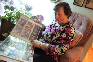 Ann Thier flips through photos of the first Carrousel of Nations in her home in Windsor on Dec. 12, 2015. Photo by Taylor Busch.