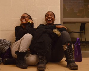 TECUMSEH ON FEB. 29 2016--- Waiting for the wrestling weigh ins for OFSAA, two girls kill time outside in the halls of the Tecumseh Vista Academy. PHOTO BY DAVID DYCK