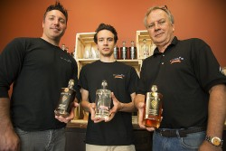 MCGREGOR, ON - Wolfhead Distillery Co-Master Distillers Karl Lonsbury (left) and Ryan Bezaire (middle) pose for a photograph with president and owner, Tom Manherz, after a media preview day at their facility in McGregor May 25. The craft distillery, first of its kind of Windsor-Essex County since prohibition, opens its doors to the public May 27. (Photo by: Justin Prince, The MediaPlex)