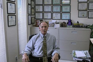 Brock Loewen is photographed behind his desk at Loewen Prosthetic Services Ltd. He is the founder of the prosthesis company.