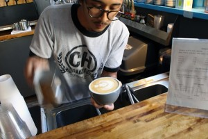 Ron Roy prepares a milk based latte with a single tulip in the centre at Craft Heads Brewery. (Photo by Brett Henderson)
