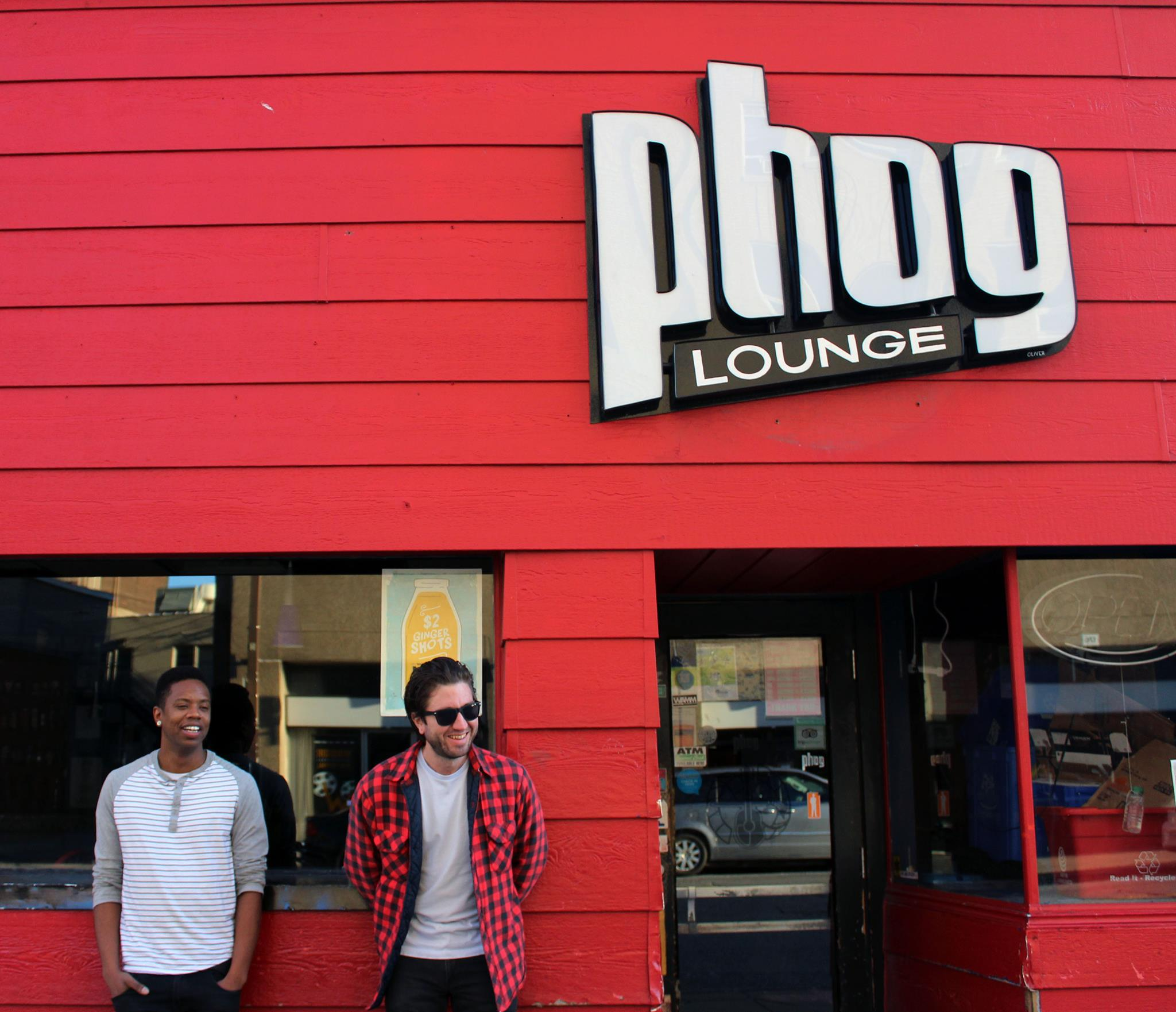 Open Mic Surgery hosts Tony Lorenzo Coates (left) and James Oltean-Lepp (right) outside Phog Lounge. (Photo by Kevin Blondin)
