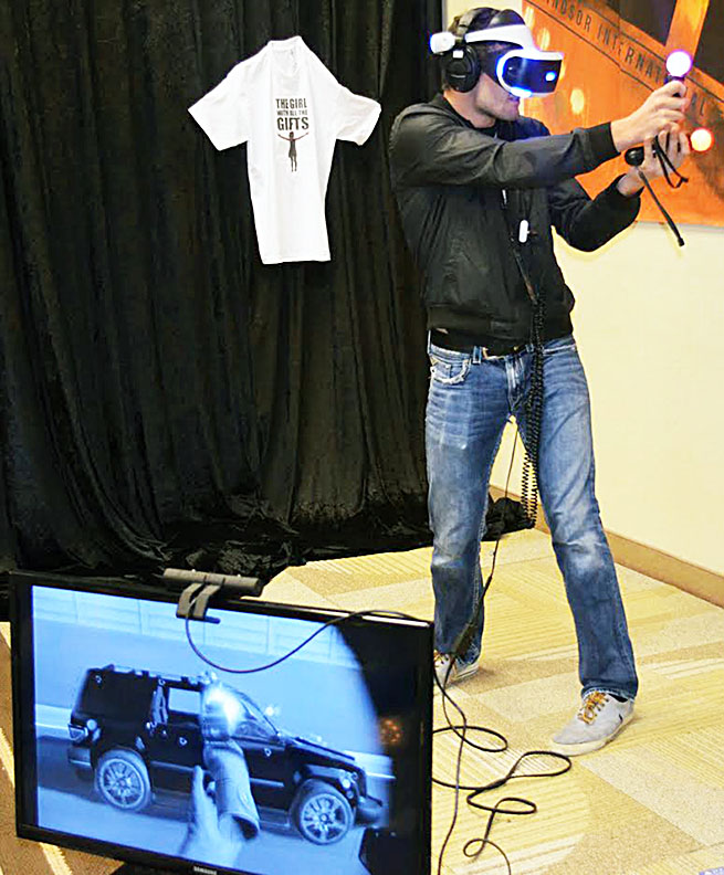 A WIFF volunteer plays The Heist on the PlayStation VR at the virtual reality station located beside the WIFF Box Office. It's one of the five virtual reality programs movie goers can get their hands on at WIFF 2016. (Photo by Nantanaa Mutharasu)