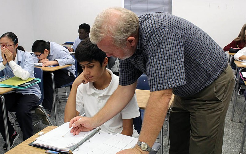 Duke Culumovic teaches students math at Catholic Central High School (Photo by Vanessa Cuevas)
