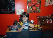 Cory Fields 9-years-old poses with his VHS tapes in his room Nov. 24