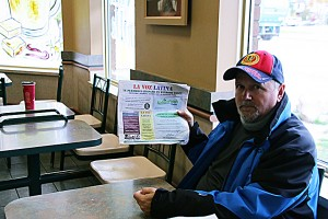 Andrew Cangiano holding a recent issue of La Voz Latina at Tim Hortons on University Ave.