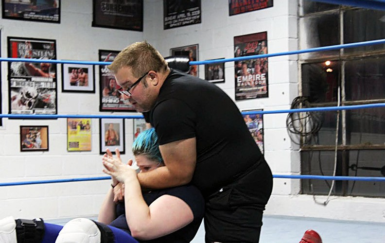Scott D'Amore applying sleeper hold on a student in the ring at the Can Am Dojo on October 18th. ( Photo by Joe Gibel )