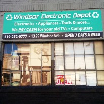 An open sign sits in the window of the Windsor Electronics Depot. (Photo by Barry Hazlehurst)