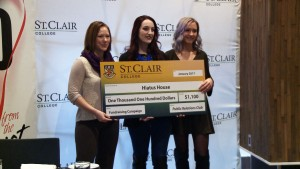 Karry Plaskitt (left) accepted the donation from the PR club Emily Borland (middle) Tori Roovers (right). Photo by Mayra Lacayo