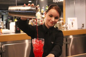 Victoria Long pours a training drink after practising her shaking technique. This is only one aspect of the hospitality management programs, which includes serving, cooking and safety tips. (Photo by Lyndi-Colleen Morgan)
