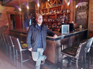 Kyle Bondy, Co-Owner of Anchor Coffee House in front of the cafe bar. (Photo by Kurlis Mati)