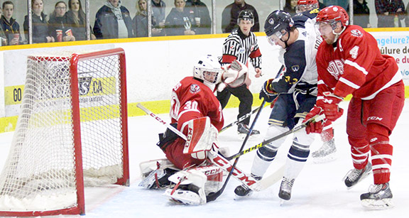 Lancers forward Kyle Hope drives the net in Game One of the OUA semi-finals March in Windsor. (Photo by Garrett Fodor)