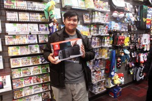George Villedas is the first person in line to purchase the Nintendo Switch at the Tecumseh Mall EB Games locations on March 3.