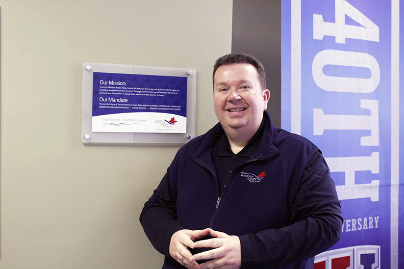 Gordon Orr, CEO of Tourism Windsor Essex Pelee Island, poses in his office. (Photo by Maryam Farag)