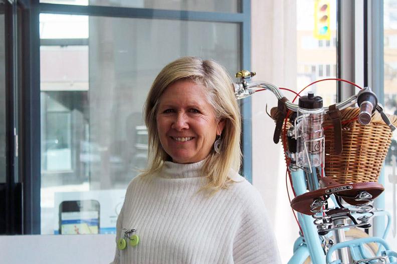 Lori Newton stands inside Bike Windsor Essex. Photo by Quentin Doak