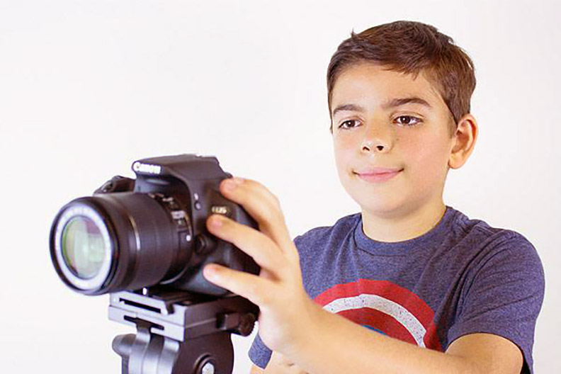 Matthew Carro, a young film camp student working with a Canon Camera. (PHOTO BY/JOHN GROUNDWATER)