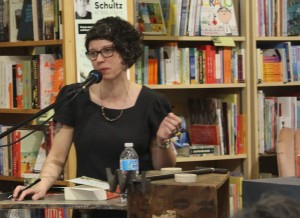 Schultz reads aloud from her book Men Walking On Water at Biblioasis. (Photo by Ryan Jones)