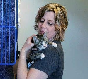 Executive Director for the Humane Society, Melanie Coulter comforts one of the cats at the Humane Society in Windsor. (Photo By Amos Johnson)
