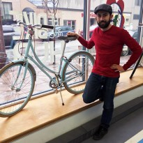 Oliver Swainson poses inside Bike Windsor-Essex.