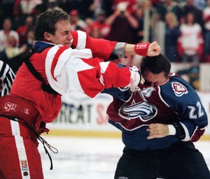 (Left to right) Darren McCarty fights Claude Lemieux after McCarty beat Lemieux to the ice earlier in the 1997 season. (Photo courtesy of The Peterborough Examiner)