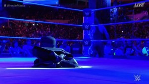The Undertaker leaves his robe and hat in the ring after a loss (Photo Courtesy of WWE staff)