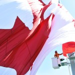 A crane operator is helping the giant Canadian flag be raised on the 45 metre poll situated in Dieppe Park at Ouellette Ave and Riverside Dr. on Saturday May 20.  Photograph by Kati Panasiuk