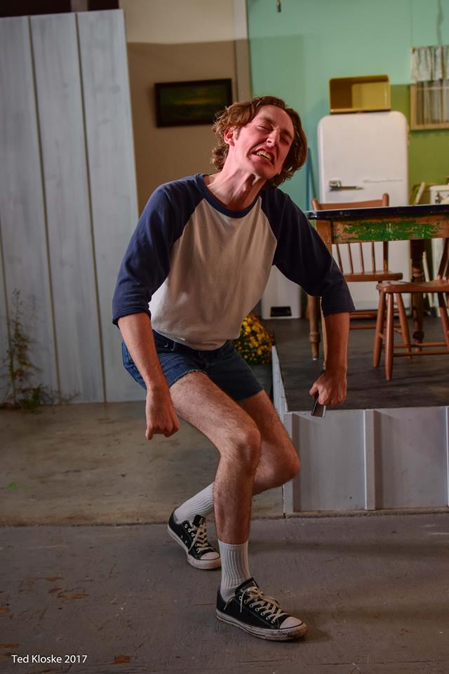Jeremy Burke impersonating a cow in The Drawer Boy at the Atelier Virginianne in Windsor, Ontario (Photo By Ted Kloske from Ghost Light Productions Facebook).