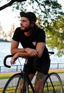 Kyle Bezaire, an avid cyclist, poses with his bike in Dieppe Park on the Detroit River in Windsor, On.