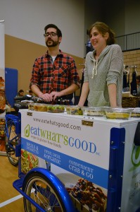 "Russell Colebrook and Emily Meko of Eat What's Good, Inc., stand in back of their ""icicle tricycle"" selling vegan foods at VegFest, which took place on Sun., Oct. 1, 2017 inside the WFCU Centre in Windsor, ON. Photo by Ken Pastushyn."