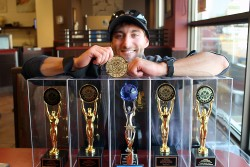 Matthew Luppino showing off his many awards in Windsor on Sept. 26,2017
