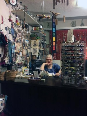 Liz Munsterhjelm sits at the front desk inside Casa Chavela. (Photo by Christina Chibani)