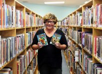 Cindy Kwa, at the Essex County Library with both a Goosebumps book and its film adaptation. (Photo by: Kurlis Mati)