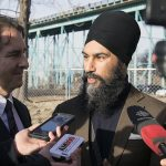 Brian Masse (left) and Jagmeet Singh (right) in scrum on corner of Indian Road and Pelissier Street. Photo by: Noah Gecelovsky