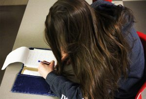 St. Clair student edits her writing in preparation for the Windsor International Writing Conference.
