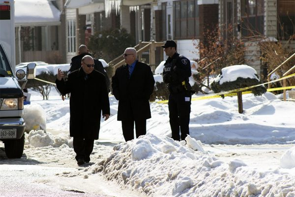Police investigating the scene after body was found in downtown Windsor on Feb. 14. (Photo by: Julianna Bonnett)