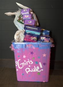 A decorated recycle bin overflows with feminine hygiene product donations at the United Way/Centraide Windsor-Essex County Tampon Tuesday event. Photo by Alyssa Leonard